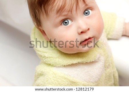 face portrait of beautiful baby in warm clother - stock photo