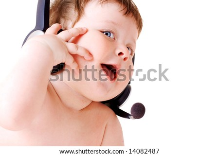 face portrait of smiling baby with headset - stock photo