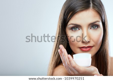 Face portrait of woman in beauty style with skin care cream. Isolated studio portrait.