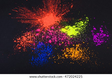 Face powder on a black background, abstract
