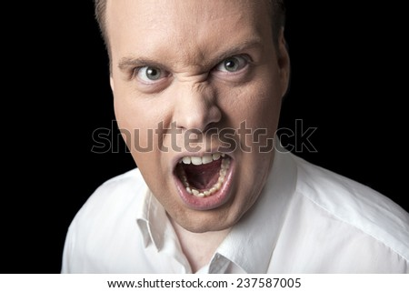 face screaming men on a black background