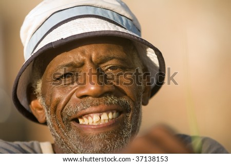Face shot of retired african american man smiling - stock photo
