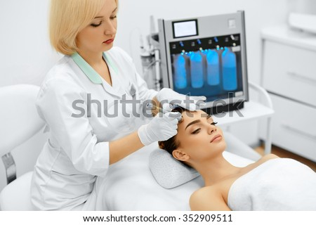 Face Skin Care. Closeup Of Beautiful Woman Getting Diamond Microdermabrasion Peeling Treatment In A Beauty Spa Salon. Cleansing Procedure. Cosmetology.  - stock photo