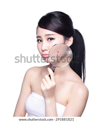 Face Skin Problem - young woman with a acne and magnifying glass check it isolated, concept for skin care, asian - stock photo