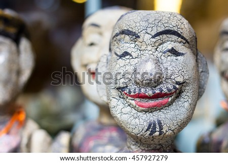 Face Smilling of The water puppet in  souvenir Shop. Water puppet is a traditional art in Hanoi, Vietnam.