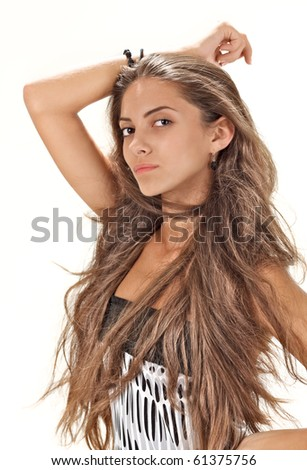 Face studio portrait of young pretty lady with long hairs on white