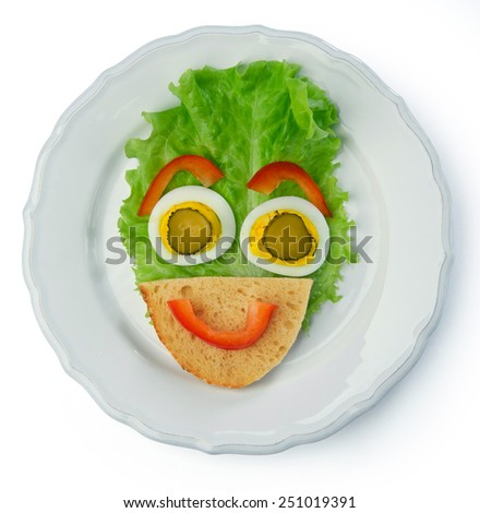 face with a smile of lettuce cucumber pepper egg bread breakfast fun for children's health