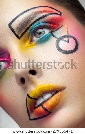 Face with creative makeup closeup