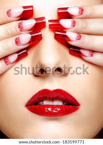 Face with eyes closed by fingers with acrylic french nails manicure - stock photo