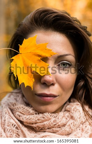face woman with yellow leaf