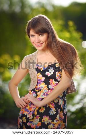 Face young beautiful girl dark closeups short hair summer park smiling. - stock photo