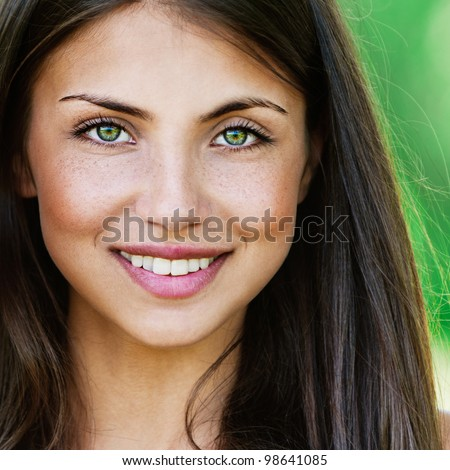 Face young beautiful girl dark closeups short hair summer park smiling - stock photo
