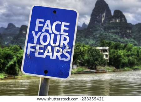 Face Your Fears sign with a rural background - stock photo