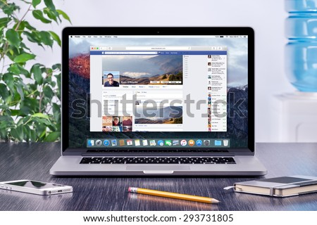 Facebook Timeline in user profile on the Apple Macbook Pro Retina screen that is on office wooden desk. Facebook is the most popular social network in the world. Varna, Bulgaria - May 31, 2015. - stock photo