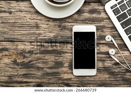Facebook. WARSZAWA, POLAND - DECEMBER 16, 2014. New Apple Iphone 6 in gray space black color with Facebook screen on working table. Facebook is one of the famous social media web site. - stock photo