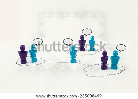 Faceless male and female figurines communicating via the cloud with speak bubbles. - stock photo