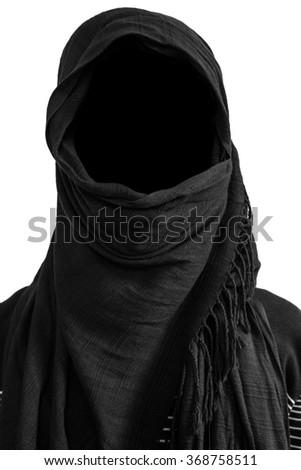 Faceless man under black veils, isolated on white background - stock photo