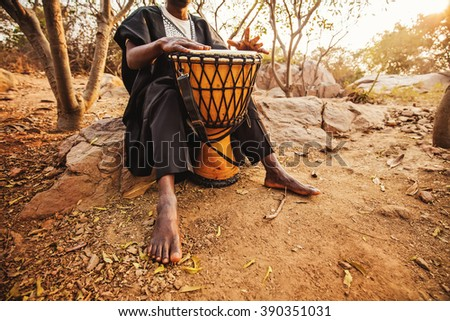 faceless photo of an african drummer playing - stock photo