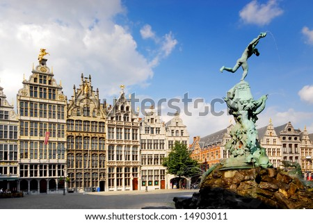 Faces of Antwerp: brabo fountain with old facade houses in the background - stock photo