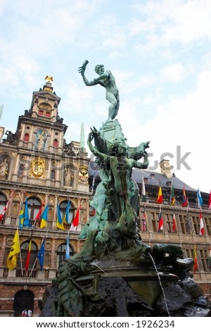Faces of Antwerp: brabo statue with city hall in the background - stock photo