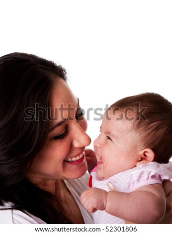 Faces of beautiful family couple of mother and daughter baby girl looking at eachother having fun and laughing, isolated. - stock photo
