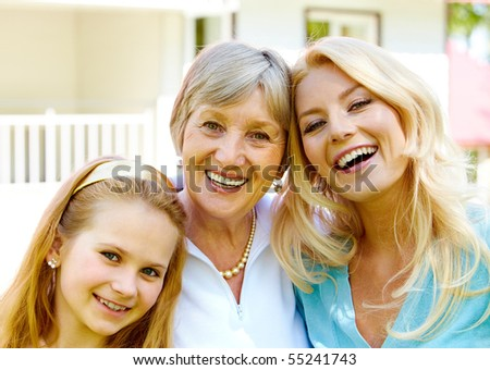 Faces of grandmother with adult daughter and granddaughter in line - stock photo