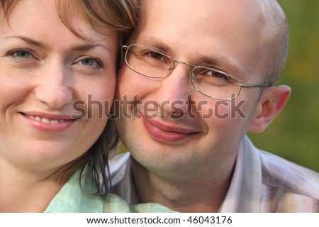 faces of happiness man and woman. man and woman are cuddling - stock photo