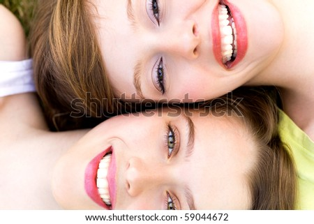 Faces of two women - stock photo