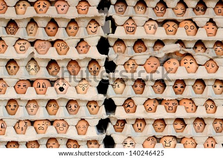 Faces on the eggs. Differences faces living together - Diversity concept - stock photo