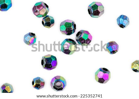 Faceted multi-colored beads isolated against white - stock photo