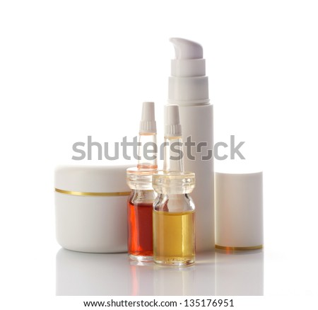 facial and body cosmetics products in white jar and glass tube isolated on white