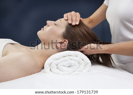 facial and neck massage - stock photo