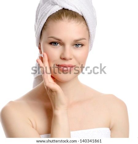 Facial care woman. Nice smiling female after bath massaging her perfect face skin with cream. Isolated on a white background. - stock photo
