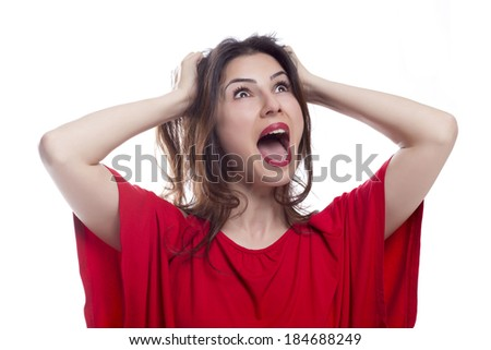 Facial expression of a beautiful young angry woman - stock photo