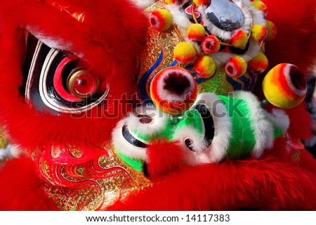 Facial makeup of Dancing Lions, Chinese New Year Parade, Vancouver, Canada - stock photo