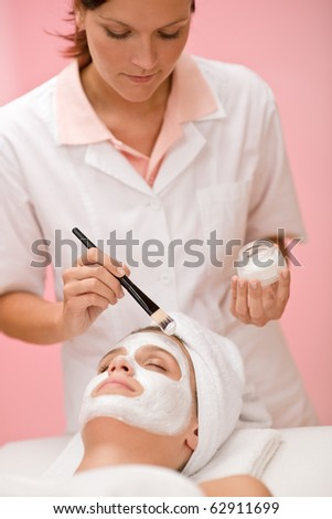 Facial mask - woman at beauty salon getting treatment