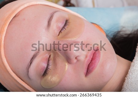 Facial massage. Cosmetic procedures facial massage. Girl in spa salon. Cosmetic facial treatments.