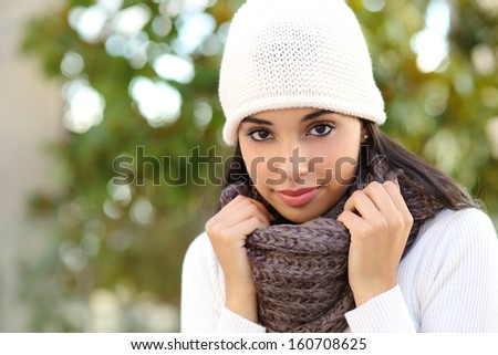 Facial portrait of a beautiful arab woman warmly clothed outdoor - stock photo