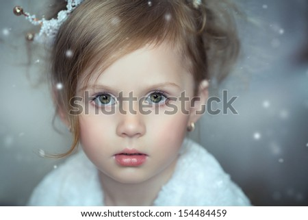 Facial portrait of a little girl with a crown on his head, collage - stock photo
