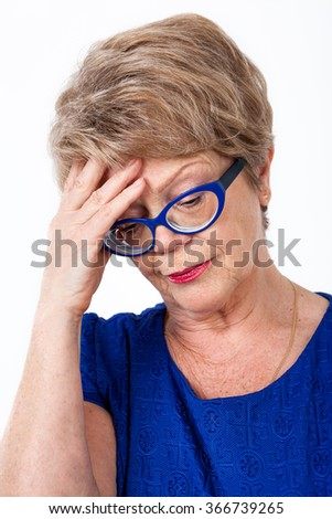 Facial portrait of stressed elderly woman, white background - stock photo