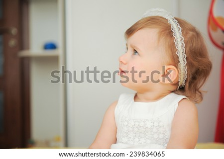 facial profile of cute girl in white dress - stock photo
