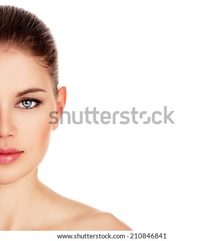 Facial skin therapy. Close-up portrait of beautiful pure woman's face isolated over white background. Young attractive Caucasian female model posing in studio.  - stock photo