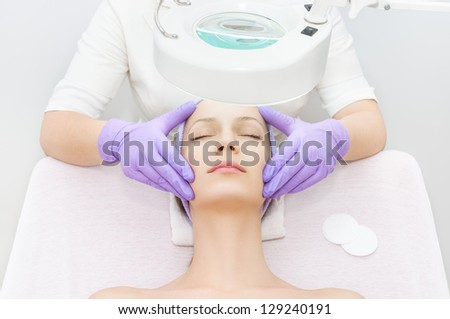 Facial treatment in spa - stock photo
