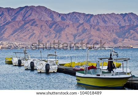 Facilities for water sport, Red Sea after sunset, Israel - stock photo