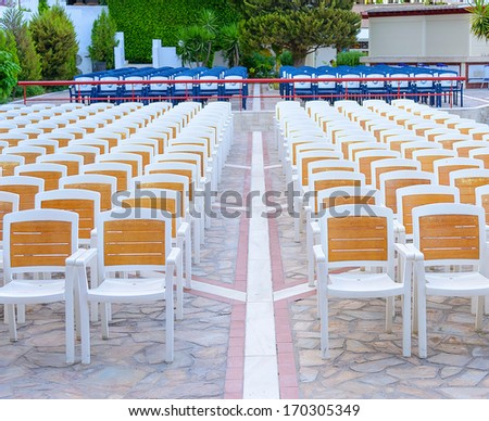 facing a number of seats for the audience in the concert hall in the open air - stock photo
