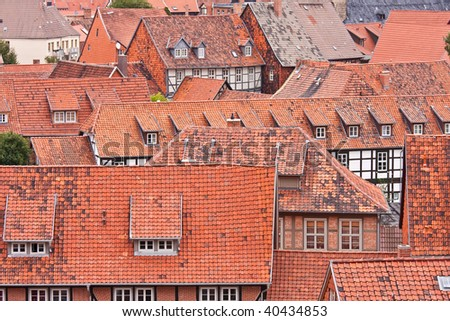 Facing at the red roofs of the medieval city Quedlinburg in Germany - stock photo
