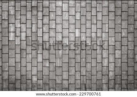 Facing gray tiles as a vintage background - stock photo