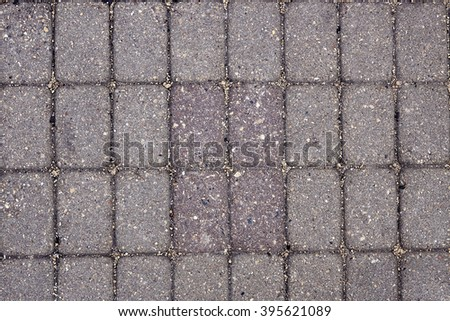 Facing gray tiles as a vintage background. Paving stone texture. Pattern - stock photo