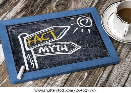 fact and myth concept signpost hand drawing on blackboard - stock photo
