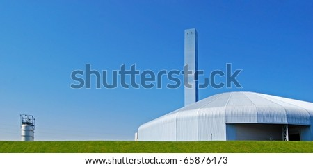 Factory - A modern incineration plant with chimney in Italy - stock photo